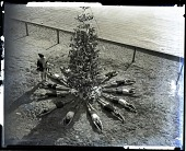 view [Santa Claus on beach with swimmers splayed around Christmas tree. non stereo photonegative,] digital asset: [Santa Claus on beach with swimmers splayed around Christmas tree. non stereo photonegative,] 1927/