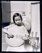 view [Asian girl with stringed instrument] : photonegative digital asset: [Asian girl with stringed instrument] : photonegative.