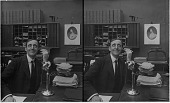 view [Office scene with man on telephone, part of a series. Active no. 7895 : stereo interpositive.] digital asset: [Office scene with man on telephone, part of a series. Active no. 7895 : stereo interpositive.]