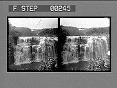 view Beautiful Middle Falls of the Genesee with Erie Ry. bridge in distance, Portage. [Active no. 13503 : stereo photonegative,] digital asset: Beautiful Middle Falls of the Genesee with Erie Ry. bridge in distance, Portage. [Active no. 13503 : stereo photonegative,] 1906.