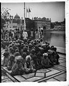 view India of to-morrow--handsome schoolboys of Amritsar, at the Golden Temple beside the Holy Tank. [Active no. 3458 : interpositive.] digital asset: India of to-morrow--handsome schoolboys of Amritsar, at the Golden Temple beside the Holy Tank. [Active no. 3458 : interpositive.]