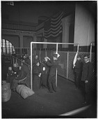 view U.S. Inspectors examining eyes of immigrants, Ellis Island, New York Harbor. [Active no. 11164 : interpositive.] digital asset: U.S. Inspectors examining eyes of immigrants, Ellis Island, New York Harbor. [Active no. 11164 : interpositive.]
