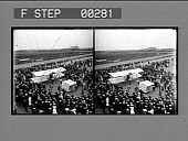 """view [Overview of crowd around early airplane, """"Formanne's airship"""".] Stereo photonegative digital asset: [Overview of crowd around early airplane, """"Formanne's airship"""".] Stereo photonegative."""