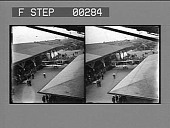 view [Overview of early airplane before stadium crowd. Stereo photonegative,] digital asset: [Overview of early airplane before stadium crowd. Stereo photonegative,] 1908.