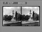 view [Statue of standing man on monument in street.] Stereo photonegative digital asset: [Statue of standing man on monument in street.] Stereo photonegative.