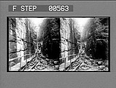 view [Interior view of deep and narrow rocky canyon with wooden walkway.] Stereo photonegative digital asset: [Interior view of deep and narrow rocky canyon with wooden walkway.] Stereo photonegative.