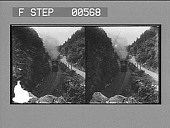 view [Train and roadway in mountain valley, New Hampshire.] Stereo photonegative digital asset: [Train and roadway in mountain valley, New Hampshire.] Stereo photonegative.