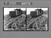 view [Train rising on trestle in mountainous area.] Stereo photonegative digital asset: [Train rising on trestle in mountainous area.] Stereo photonegative.