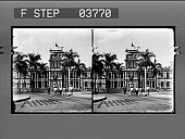 view [Honolulu; Front view of Palace with U.S. Flag at half staff; line of youths in front of monument.] [photonegative.] digital asset: [Honolulu; Front view of Palace with U.S. Flag at half staff; line of youths in front of monument.] [photonegative.]