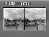 view [Honolulu; street and bridge over waterway; mountain ridge in background.] [photonegative.] digital asset: [Honolulu; street and bridge over waterway; mountain ridge in background.] [photonegative.]