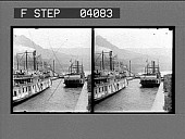 view [Boats on canal in mountains. Active no. 1255 : stereo photonegative.] digital asset: [Boats on canal in mountains. Active no. 1255 : stereo photonegative.]