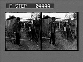 view [Boy and man in farmyard : stereoscopic photonegative.] digital asset: [Boy and man in farmyard : stereoscopic photonegative.]