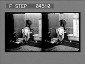 view [Woman given foot bath in home. Stereo photonegative.] digital asset: [Woman given foot bath in home. Stereo photonegative.]
