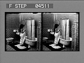view [Woman prepares to enter bathtub in home. Stereo photonegative.] digital asset: [Woman prepares to enter bathtub in home. Stereo photonegative.]