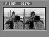 view Loaded cars ascending, empties descending at the tipple, coal mine. 13222 interpositive digital asset: Loaded cars ascending, empties descending at the tipple, coal mine. 13222 interpositive 1906.