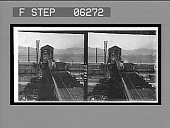 view Loaded cars ascending, empties descending at the tipple, coal mine. 13222 interpositive digital asset: Loaded cars ascending, empties descending at the tipple, coal mine. 13222 interpositive.