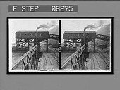 view A coal mine tipple where coal is weighed and loaded into freight cars. 13223 interpositive digital asset: A coal mine tipple where coal is weighed and loaded into freight cars. 13223 interpositive.