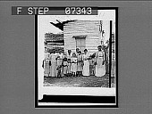 view [Adults and children pose before small building in Cuba. Active no. 111 : non-stereo interpositive.] digital asset: [Adults and children pose before small building in Cuba. Active no. 111 : non-stereo interpositive.]