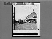 view [Honolulu; railway station with two trains, horse-drawn carriage and crowd.] 35 Interpositive digital asset: [Honolulu; railway station with two trains, horse-drawn carriage and crowd.] 35 Interpositive.