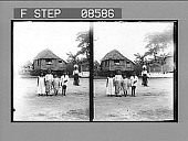 view [Four children pose in front of rustic home.] 406 photonegative digital asset: [Four children pose in front of rustic home.] 406 photonegative.