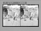 view Work and gossip at a fountain by the Cappuccini gate in Taormini's old city wall. 8602 Photonegative digital asset: Work and gossip at a fountain by the Cappuccini gate in Taormini's old city wall. 8602 Photonegative 1905.