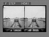 view East chamber, lower locks, from construction trestle toward Panama, Miraflores. 1913 stage--the completed canal and canal locks before letting in the water. 11477 Photonegative digital asset: East chamber, lower locks, from construction trestle toward Panama, Miraflores. 1913 stage--the completed canal and canal locks before letting in the water. 11477 Photonegative 1913