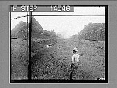 view Lookikng south from Obispo toward Las Cascadas, over finished canal. 1913 stage--completed canal and locks before letting in water. 11480 photonegative digital asset: Lookikng south from Obispo toward Las Cascadas, over finished canal. 1913 stage--completed canal and locks before letting in water. 11480 photonegative 1913.