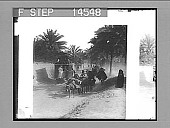 view Peculiar double-decked horse cars on a suburban street, Bagdad, Mesopotamia. No. 11483 : photonegative digital asset: Peculiar double-decked horse cars on a suburban street, Bagdad, Mesopotamia. No. 11483 : photonegative, 1912.