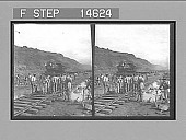 view Spanish laborers at work in Culebra Cut and loaded train hauling dirt from canal. 11525 photonegative digital asset: Spanish laborers at work in Culebra Cut and loaded train hauling dirt from canal. 11525 photonegative 1913.