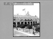 """view """"Liberty's Birth in Cuba--raising first American Flag over Palace, noon, Jan. 1, 1899, Havana. Copyright 1899 by Strohmeyer & Wyman."""" (on negative). Active no. 20177 : photonegative digital asset: """"Liberty's Birth in Cuba--raising first American Flag over Palace, noon, Jan. 1, 1899, Havana. Copyright 1899 by Strohmeyer & Wyman."""" (on negative). Active no. 20177 : photonegative, 1899."""
