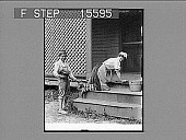 view [Woman scrubbing steps of home with mischievous boy behind her. Active No. 21601 : photonegative.] digital asset: [Woman scrubbing steps of home with mischievous boy behind her. Active No. 21601 : photonegative.]
