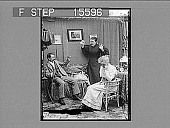 view [Man on sofa and woman on chair draw reaction from her mother. Active no. 21612 : half-stereo photonegative.] digital asset: [Man on sofa and woman on chair draw reaction from her mother. Active no. 21612 : half-stereo photonegative.]