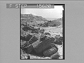 view [Seacoast with figure on rock. Active no. 22063 :? non-stereo photonegative.] digital asset number 1