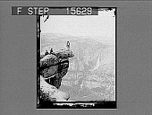 view [Tourists on dramatic projecting rock ledge, Yosemite Falls in gackground. Active no. 22076 : non-stereo photonegative.] digital asset: [Tourists on dramatic projecting rock ledge, Yosemite Falls in gackground. Active no. 22076 : non-stereo photonegative.]