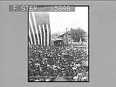 view [Political train stop with crowd and U.S. Flag. Active no. 22096 : half-stereo photonegative.] digital asset: [Political train stop with crowd and U.S. Flag. Active no. 22096 : half-stereo photonegative.]
