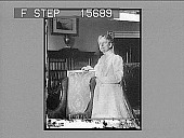 view [Portrait, 3/4 length, of a woman, in domestic interior. Active no. 22149 : non-stereo photonegative.] digital asset number 1