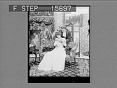 view [Couple in home living room, dressed in evening wear. Active no. 22161 : non-stereo photonegative.] digital asset: [Couple in home living room, dressed in evening wear. Active no. 22161 : non-stereo photonegative.]