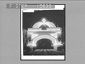 view [Rail lines under lighted welcome arch in New York City. Active no. 22590 : non-stereo photonegative.] digital asset: [Rail lines under lighted welcome arch in New York City. Active no. 22590 : non-stereo photonegative.]