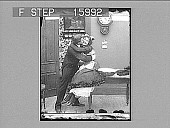 view [Husband kissing maid in home kitchen. Active no. 23211 : black-and-white half-stereo photonegative.] digital asset: [Husband kissing maid in home kitchen. Active no. 23211 : black-and-white half-stereo photonegative.]