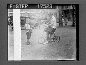 view CAMBRIDGE, MASS.: Miss Helen Freeman, of Grand Rapids, Mich., a Radcliffe College girl, also a student attending Sargent School, takes lessons from little Carl Behr, of Cambridge, Mass., in the art of riding the latest edition of children's bicycle. 5/... digital asset: CAMBRIDGE, MASS.: Miss Helen Freeman, of Grand Rapids, Mich., a Radcliffe College girl, also a student attending Sargent School, takes lessons from little Carl Behr, of Cambridge, Mass., in the art of riding the latest edition of children's bicycle. 5/4/26. [Active no. 1752 : photonegative.]