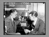 view The Mystery Radio!--Dr. Riggs granted 40 patents on revolutionary set based on entirely new principles. New York: Left, Donald F. Hastings, assistant to Dr. Riggs, discussing the amplifier with the inventor. This amplifier is but 5 inches wide by 3 inc... digital asset: The Mystery Radio!--Dr. Riggs granted 40 patents on revolutionary set based on entirely new principles. New York: Left, Donald F. Hastings, assistant to Dr. Riggs, discussing the amplifier with the inventor. This amplifier is but 5 inches wide by 3 inches high, yet it will fill the largest autidorium with music, it is asserted. Two of the revolutionary tubes are shown on top of the amplifier. The box contains a complete outfit for operting a set from house current. The set can operate on either A.C. or D.C. with identical quality and volume. 1796 photonegative.