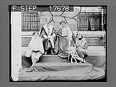 view [Campus queen seated outside with king and court at college in Massachusetts.] Cat. no. 1881 : non-stereo photonegative digital asset: [Campus queen seated outside with king and court at college in Massachusetts.] Cat. no. 1881 : non-stereo photonegative, 1926.
