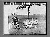 "view Chasing the ""golf blues"" with the aid of a bagpipe. [photonegative] digital asset: Chasing the ""golf blues"" with the aid of a bagpipe. [photonegative], 7/3/1926."