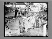 view Submarine S-51 goes aground in East River after wreck of two forward pontoons. [photonegative] digital asset: Submarine S-51 goes aground in East River after wreck of two forward pontoons. [photonegative], 07/07/1926.