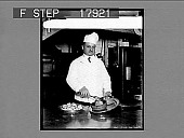 view [Eugene Thomas, chef at the Waldorf-Astoria in New York City. Active no. 2442 : non-stereo photonegative.] digital asset: [Eugene Thomas, chef at the Waldorf-Astoria in New York City. Active no. 2442 : non-stereo photonegative.]