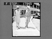 view [Two women walking on city sidewalk.] 1235 photonegative digital asset: [Two women walking on city sidewalk.] 1235 photonegative.