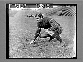 view Football player on field in empty stadium. 10084 photonegative digital asset: Football player on field in empty stadium. 10084 photonegative.