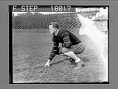 view Football player on field in empty stadium. 10085 photonegative digital asset: Football player on field in empty stadium. 10085 photonegative.