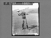view Football player preparing to pass ball on field. 10089 photonegative digital asset: Football player preparing to pass ball on field. 10089 photonegative.