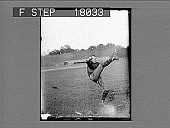 view Football player kicking ball on field in empty stadium. 10093 photonegative digital asset: Football player kicking ball on field in empty stadium. 10093 photonegative.